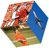 a cube showing a cheerleader, a touch football player, and an airplane